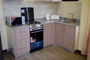 A kitchen or kitchenette at New Avon Apartments