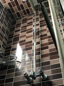 A bathroom at New Avon Apartments