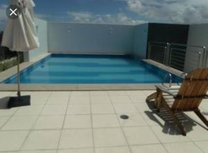 A piscina localizada em Apartamento na Ponta Verde ou nos arredores