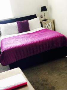 A bed or beds in a room at The Ship Leopard Boutique Hotel