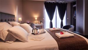 Un ou plusieurs lits dans un hébergement de l'établissement Villa Romeo