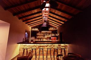 The lounge or bar area at Jungle Lodge Tikal Hostal