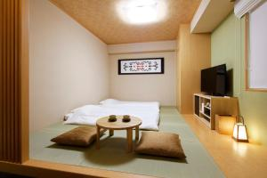A television and/or entertainment center at karaksa hotel Sapporo