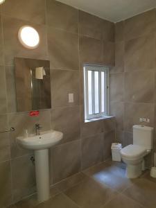 A bathroom at Mavina Hotel & Apartments