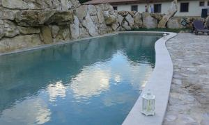 The swimming pool at or near Valle Dei Pini