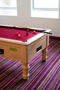A pool table at Safestay London Elephant & Castle