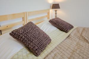 Een bed of bedden in een kamer bij Hotel Corfwater