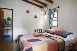 A bed or beds in a room at Villas Macondo