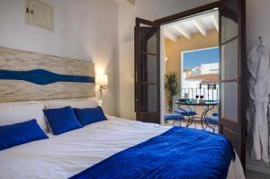 Säng eller sängar i ett rum på StayCatalina Boutique Hotel-Apartments