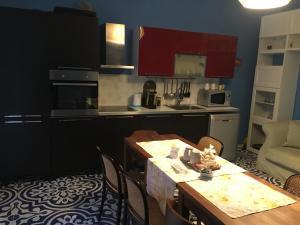 A kitchen or kitchenette at B&B Villa Italia