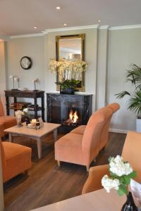 Ein Sitzbereich in der Unterkunft Fletcher Hotel Restaurant De Witte Raaf