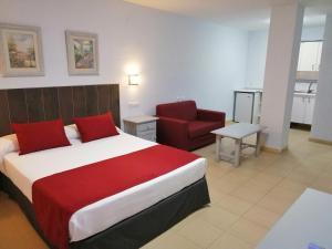 A bed or beds in a room at Apartamentos Puerta del Sur