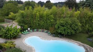 A view of the pool at Au Faisan Doré or nearby