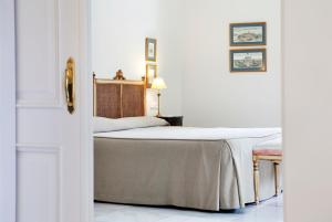 A bed or beds in a room at Villa Jerez