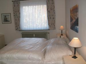 Ein Bett oder Betten in einem Zimmer der Unterkunft Sylt