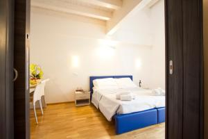 Cama ou camas em um quarto em Hotel Arezzo Sport College