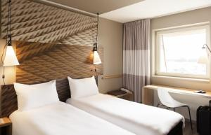 A bed or beds in a room at ibis Coventry Centre