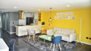 Zona de estar de Espectaculares Apartamentos Deluxe