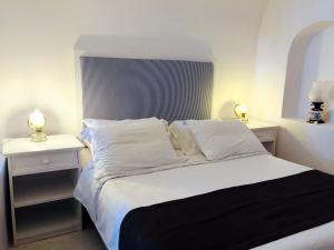 A bed or beds in a room at Aigialos Luxury Traditional Settlement