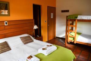Una cama o camas cuchetas en una habitación  de Rancho Grande