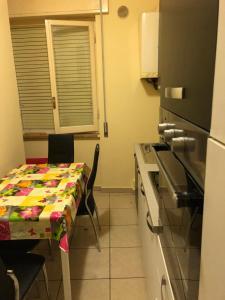 A kitchen or kitchenette at Terni In Centro