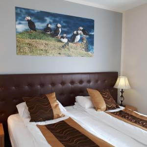 A bed or beds in a room at Hotel Jazz self-service Hotel by Keflavik Airport