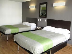 A bed or beds in a room at Studio 6-Alexandria, LA