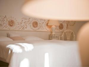 Ein Bett oder Betten in einem Zimmer der Unterkunft Mooslechners Rusterhof