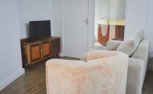 Uma área de estar em Hotel San Ghermann