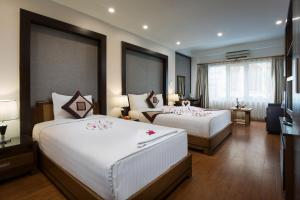 A bed or beds in a room at Splendid Star Grand Hotel and Spa
