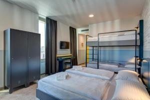 Letto o letti in una camera di MEININGER Milano Lambrate