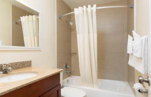 A bathroom at Days Inn by Wyndham Miami Airport North