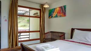 A bed or beds in a room at Ayana Holiday Resort