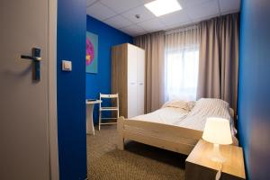 A bed or beds in a room at Moon Hostel