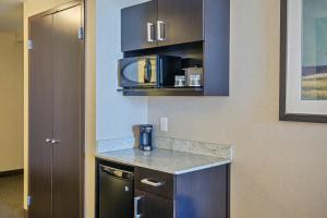 A kitchen or kitchenette at Holiday Inn Saskatoon Downtown, an IHG Hotel