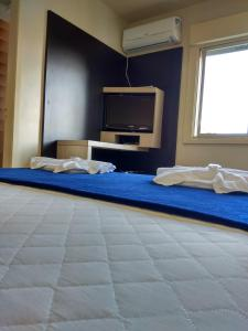 A bed or beds in a room at Soratur Hotel & Coworking