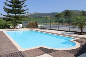 The swimming pool at or near Montejunto Eden