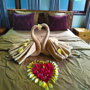 Ein Bett oder Betten in einem Zimmer der Unterkunft Lucky Family Cottage