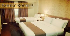 A bed or beds in a room at GT Hotel Iloilo