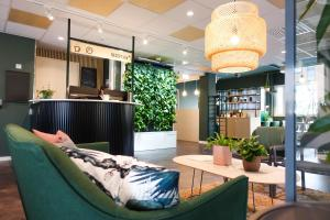 The lobby or reception area at GreenStar Hotel Jyväskylä