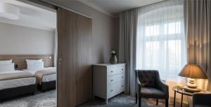 A bed or beds in a room at Best Western Hotel Via Regia