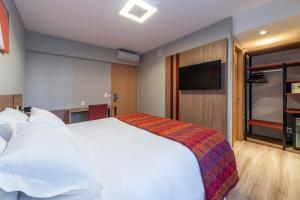 Cama ou camas em um quarto em Hotel Laghetto Stilo Higienópolis