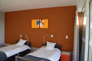 Ein Bett oder Betten in einem Zimmer der Unterkunft Hotel Middelpunt