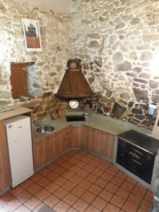 A kitchen or kitchenette at Loft Rural Corte de Fora