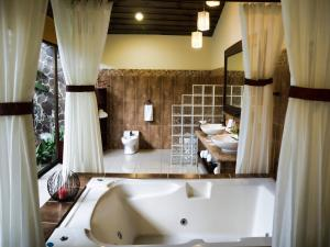 A bathroom at Hotel Arenal Springs Resort & Spa