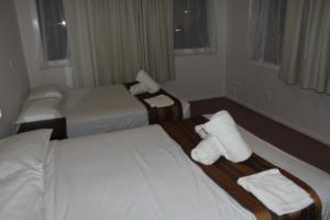 A bed or beds in a room at Normandie Inn and Function Centre