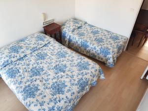 A bed or beds in a room at Hotel La Cle Du Sud