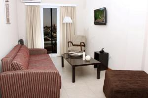 Un lugar para sentarse en De Los Arroyos Apart Hotel