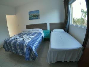 Cama ou camas em um quarto em Pousada Acquaville