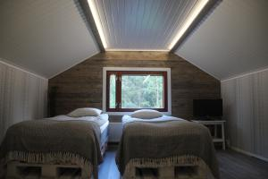 A bed or beds in a room at Beautiful holiday home (studio) in Rovaniemi